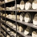 A shelf of dinnerware from Martha's prop shop