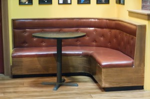 The banquette after painting and upholstery