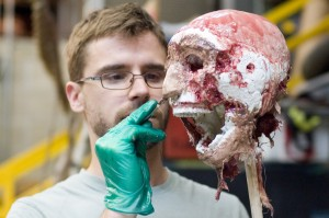 Eric Hart coats the skull with Dragon Skin