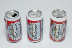 A real can, and two prop cans with fake labels