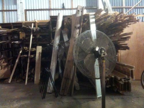 Pile of lumber, beams, and flooring
