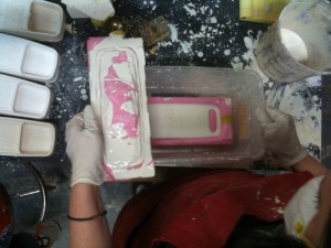 Pouring the plaster into the mold