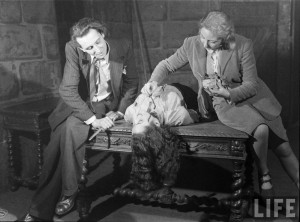 "Eva Berkson applies blood to an actress' neck before a scene from ""The Hussy"". Photograph by Hans Wild, 1947"