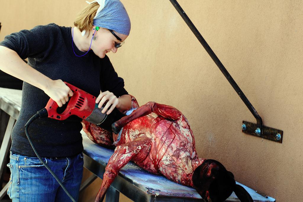 Amy Slater cuts a fake goat apart