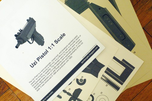 A papercraft Uzi printed from the internet