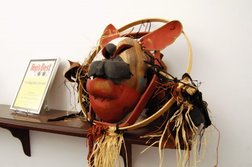dog mask made of wooden bowls