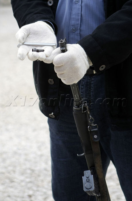 Hungarian Counter Terrorism officers show weapons seized
