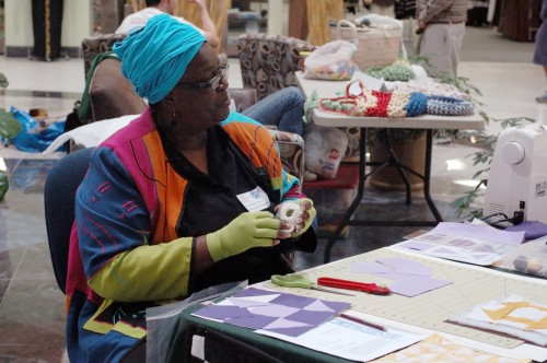 Meltonia Young making Underground Railroad quilts