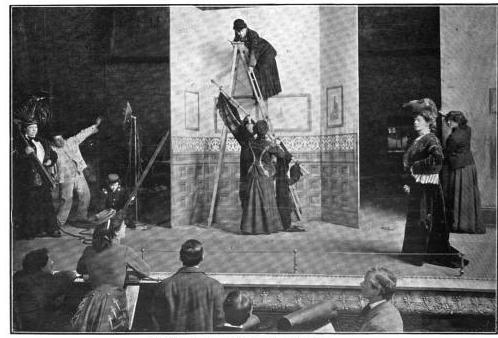Miss Gertrude Haynes directing the setting of the scenes