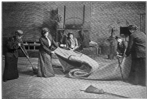 Members of the manless theatrical company engaged in scene-shifting
