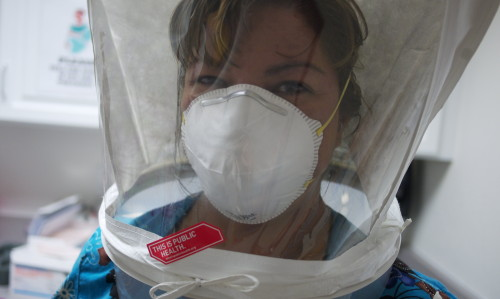"""""""Fit Testing the N95 Mask"""" by AlamosaCounty PublicHealth is licensed under CC BY 2.0"""
