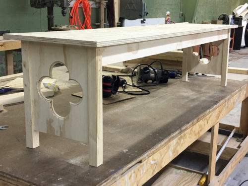 The unpainted bench